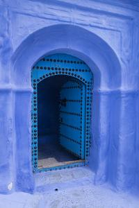 Morocco. A traditional blue doorway in the hill town of Chefchaouen. by Brenda Tharp