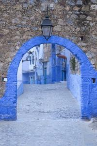 Morocco, Chefchaouen. a Blue Arch and Quiet Street Entering the Medina of the Village by Brenda Tharp