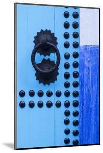 Morocco, Chefchaouen. Detail of blue door and doorknocker by Brenda Tharp