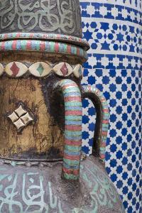 Morocco, Fes. Vase and pillar details with traditional design in the interior of a riad. by Brenda Tharp