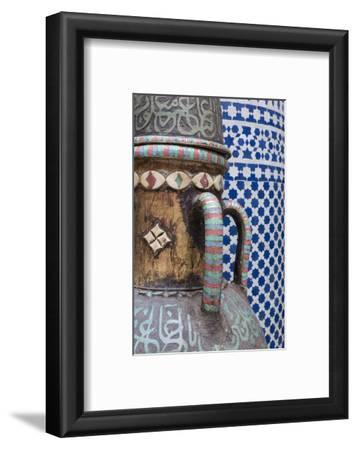 Morocco, Fes. Vase and pillar details with traditional design in the interior of a riad.