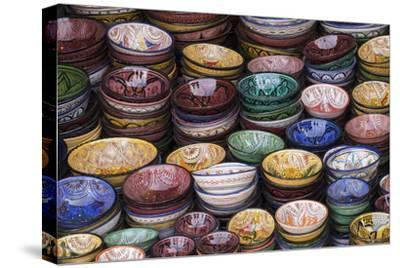 Morocco, Marrakech. Colorfully painted ceramic bowls for sale in a souk, a shop.