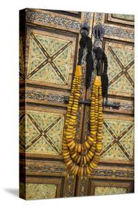 Morocco, Tinerhir. Traditional necklace of Berber woman hangs on a cabinet with camel-bone inlay by Brenda Tharp