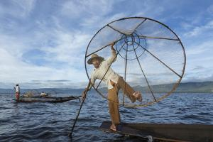 Myanmar, Inle Lake. Young Fisherman Demonstrates a Traditional Rowing Technique by Brenda Tharp
