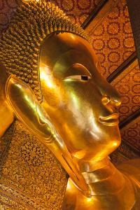 Thailand, Bangkok. Close-up of the head of the Reclining Buddha inside Wat Pho. by Brenda Tharp