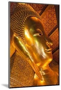 Thailand, Bangkok. Close-up of the head of the Reclining Buddha inside Wat Pho. by Brenda Tharp
