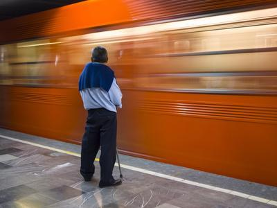 A Mexican Citizen Waits for the Metro to Stop, Mexico City, Mexico