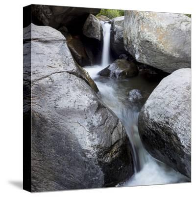 Idaho, USA. Squaw Creek waterfall detail with boulders.