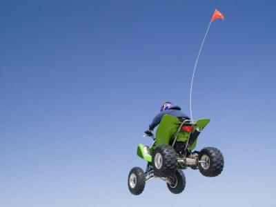 Airborne Atv Rider, Pismo Beach, California by Brent Winebrenner