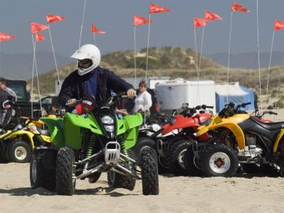 ATV Riders in Dunes by Brent Winebrenner
