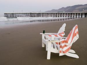 Beach Chairs and Pier at Sunrise, Pismo Beach, California by Brent Winebrenner