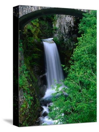 Christine Falls Through the Arch of a Stone Bridge, Mt. Rainier National Park, USA
