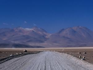 Dirt Road with Mountains Behind Near Lake Verde, Lake Verde, Bolivia by Brent Winebrenner