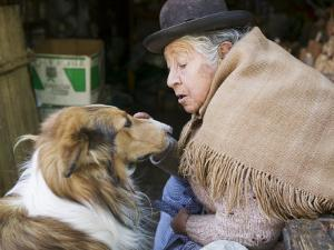 Elderly Female Vendor at Mercado de Los Brujas with Her Dog, La Paz, Bolivia by Brent Winebrenner