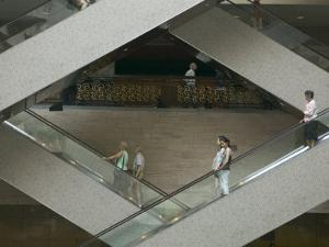 Escalators in the Shanghai Museum, Shanghai, China by Brent Winebrenner