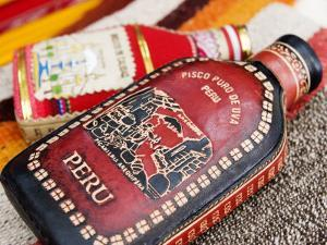 Leather and Cloth Flask Covers, Peru by Brent Winebrenner