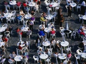 Overhead of People Relaxing in Outdoor Cafe, Old Town Square, Prague, Czech Republic by Brent Winebrenner