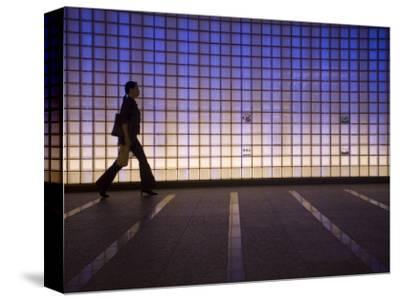 Pedestrian in a Neon-Lit Passageway in Namba Station