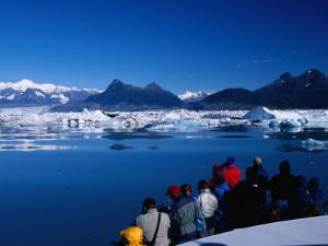 People on Tour Boat Looking Over Columbia Glacier, Prince William Sound, USA by Brent Winebrenner