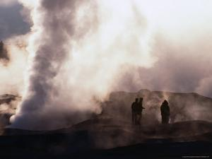 People Silhouetted Against Steam from Geyser Vent, Sol De Manana, Bolivia by Brent Winebrenner