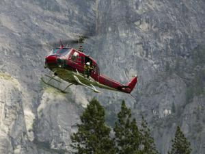 Rescue Helicopter in Front of One of Yosemite Valley's Big Walls by Brent Winebrenner