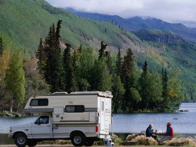 RV Camping Couple Stop for a Break on the Shores of Long Lake along the Glenn Highway, Alaska