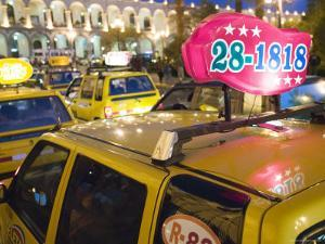 Taxi Cab Jam in Plaza de Armas, Arequipa, Peru by Brent Winebrenner