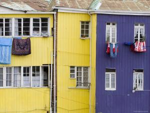 Washing Hanging outside Colourful Houses on Calle Guimera, Valparaiso, Chile by Brent Winebrenner