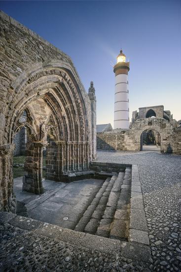 Bretagne, Phare Saint Mathieu Et Porche De L'Eglise Notre Dame De Grâce-Philippe Manguin-Photographic Print