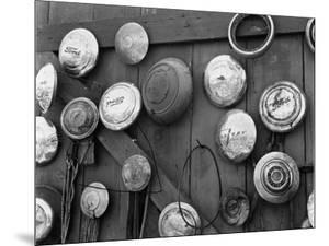 Hubcaps, c. 1940 by Brett Weston