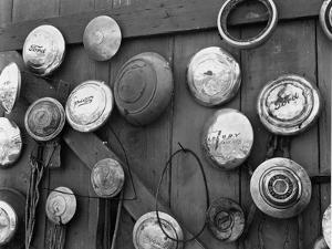 Hubcaps, c. 1940 by Brett Weston