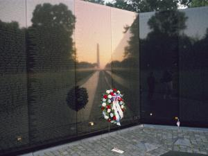 A Memorial Wreath is Placed at the Base of the Vietnam Veterans Memorial by Brian Gordon Green
