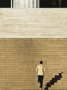 An Early Morning Jogger Casts His Shadow on the Lincoln Memorial Steps by Brian Gordon Green