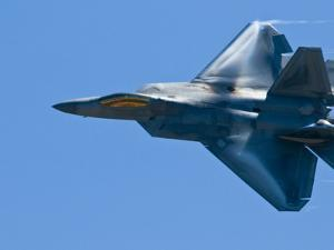 An F22 Raptor Fighter Jet Performing at a Military Air Show by Brian Gordon Green