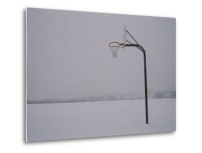 Basketball Goal Standing by Itself in the Middle of a Blizzard