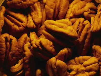 Close View of Shelled Pecans in Warm Light by Brian Gordon Green