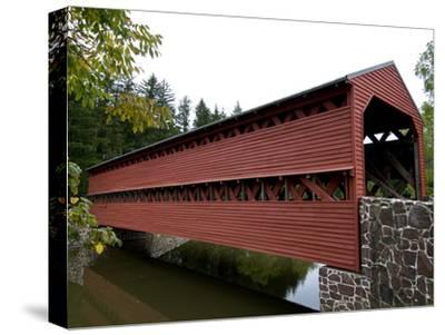 Covered Bridge over a Calm Stream