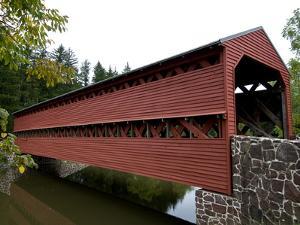 Covered Bridge over a Calm Stream by Brian Gordon Green