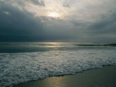 Dramatic View of a Stormy Sunrise and the Foamy Surf