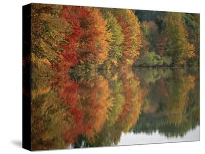 Fall Foliage Around Churchill Lake is Reflected in the Still Water