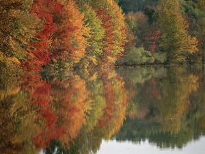 Fall Foliage Around Churchill Lake is Reflected in the Still Water by Brian Gordon Green