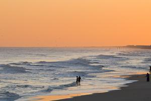 People Playing in the Water at Sunset by Brian Gordon Green