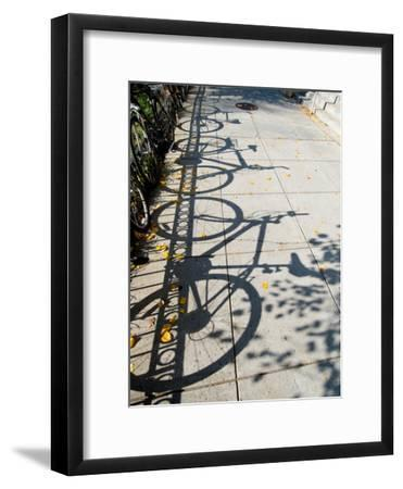 Shadows of Bicycles Cast on a Side Walk