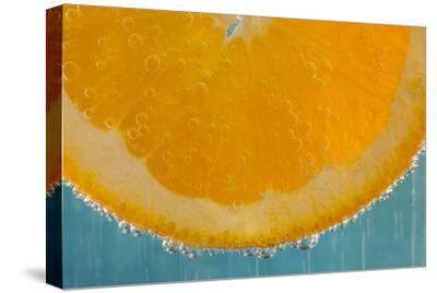 A Slice of Orange in a Glass of Sparkling Mineral Water