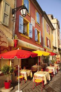 Colorful Cafe and Street Scene in Greoux-Les-Bains, Provence, France by Brian Jannsen