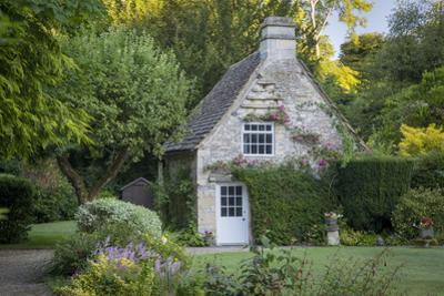 Early Morning Cottage in Castle Combe, Wiltshire, England by Brian Jannsen