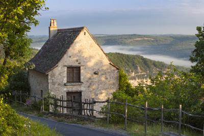 Morning Mist Along River Lot, Cottage in Saint Cirq Lapopie, Midi-Pyrenees France by Brian Jannsen