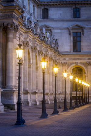 Row of Lamps in the Courtyard of Musee Du Louvre, Paris, France by Brian Jannsen