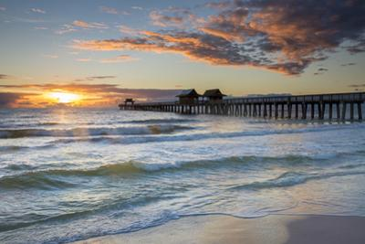 Sunset over the Naples Pier on the West Coast of Florida, Usa by Brian Jannsen