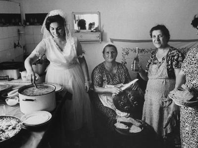 Bride Assisting in Kitchen During Wedding-Paul Schutzer-Photographic Print